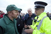 James Badman Farmers For Action organiser talking to Police. Farmers protest against the low price of milk. Robert Wiseman distribution centre, near Bridgewater. - Paul Box - 19-07-2012