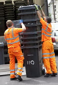Bristol council remove large wheelie bins and replace them with smaller bins to reduce waste, Bristol. - Paul Box - 2010s,2012,bin,bin man,bin man binmen,bin men,binman,binmen,bins,black,by hand,cities,city,collection,collector,council,council service,Council Workers,domestic,dustman,dustmen,employee,employees,Empl