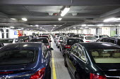 The car deck on a DFDS Seaways ferry crossing the Channel from Dover UK to Dunkirk, France. - Paul Box - 2010s,2012,AUTO,AUTOMOBILE,AUTOMOBILES,AUTOMOTIVE,boat,boats,car,cargo,cars,cross,Cross Channel Ferry,crosses,crossing,deck,EBF,Economic,Economy,ferries,ferry,marine,maritime,maritime industry,nautica