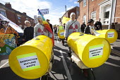 Stop new nuclear protesters march through Bridgwater to protest about EDF Energy's plans to build a new nuclear reactor at Hinkley point, Hinkley C power plant Somerset. And also to protest about plan... - Paul Box - 06-10-2012