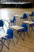 Room being made ready for school examinations. - Paul Box - 2000s,2005,and,chair,chairs,class,classroom,CLASSROOMS,comprehensive,COMPREHENSIVES,desks,EDU Education,exam,examination,examinations,examining,exams,grade,grades,halls,knowledge,of,qualification,qual
