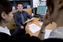 An IT consultancy business Bristol. Having a team meeting. - Paul Box - 13-12-2005