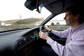 An office worker commuting on the M4, Bristol - Paul Box - 13-12-2005