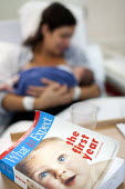 A book What to expect in the first year, about the first year of raising a child. The mother is an IVF patient who has obstetric cholestasis a rare complication of pregnancy. Which is a build-up of bi... - Paul Box - ,2010s,2012,adult,adults,BABIES,baby,baby babies,baby books,baby boy,book,book books,BOOKS,boy boys,breast,breastfeeding,care,CHILD,child children,childbirth,CHILDHOOD,CHILDREN,cities,city,EARLY YEARS