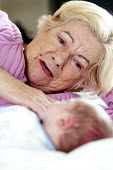 A grandmother cuddles her new grandson. - Paul Box - 28-09-2012
