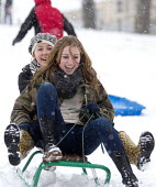 Children having fun in the snow, St Andrews Park , Bristol. - Paul Box - ,2010s,2013,adolescence,adolescent,adolescents,child,CHILDHOOD,children,cities,city,CLIMATE,cold,conditions,enjoy,enjoying,enjoyment,excited,excitement,exciting,female,females,frozen,funny,girl,girls,