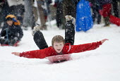 Children having fun in the snow, St Andrews Park , Bristol. - Paul Box - ,2010s,2013,boy,boys,child,CHILDHOOD,children,cities,city,CLIMATE,cold,conditions,enjoy,enjoying,enjoyment,excited,excitement,exciting,frozen,having fun,hill,hills,juvenile,juveniles,kid,kids,Leisure,