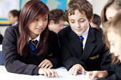 Pupils helping each other in a Geography lesson, looking a maps, Clevedon school, Clevedon - Paul Box - 2010s,2011,adolescence,adolescent,adolescents,asian,asians,assisting,BAME,BAMEs,black,BME,bmes,child,CHILDHOOD,children,cities,city,class,classroom,classrooms,communicating,communication,conversation,