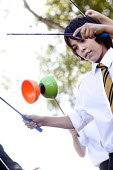 Pupil playing with a diabolo, Clevedon school, Clevedon - Paul Box - 2010s,2011,a,adolescence,adolescent,adolescents,child,CHILDHOOD,children,cities,city,CONCENTRATE,concentrating,concentration,confidence,diabolo,edu,educate,educating,education,educational,enjoying,enj