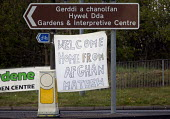 Welcome home from the war in Afghanistan banner on a roundabout near Narbeth, Wales - Paul Box - 2010s,2012,Afghanistan,armed forces,army,conflict,conflicts,home,military,returning,roundabout,SERVICE,SERVICES,soldier,soldiers,UCW,Wales,war,Welsh