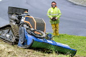Deltrak Irus a remote control mower and ground clearance machine being used by council workers for clearing ground at the side of main roads. Wales. Used for maintaining brush and scrubland in normall... - Paul Box - 26-11-2012
