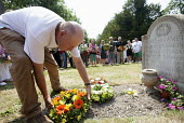 Wreaths are laid at the grave of James Hammett one of the Tolpuddle Martyrs. Tolpuddle Martyrs Festival. Tolpuddle - Paul Box - 2010s,2013,cemeteries,cemetery,flower,flowering,flowers,grave,graves,graveyard,Graveyards,member,member members,members,people,SWTUC,Tolpuddle,Tolpuddle Martyrs' Festival,Trade Union,Trade Union,trade
