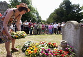 Frances OGrady TUC Gen Sec lays a wreath at the grave of James Hammett one of the Tolpuddle Martyrs. Tolpuddle Martyrs Festival. Tolpuddle - Paul Box - 2010s,2013,cemeteries,cemetery,FEMALE,floral,flower,flowering,flowers,grave,graves,graveyard,Graveyards,member,member members,members,people,person,persons,SWTUC,Tolpuddle,Tolpuddle Martyrs' Festival,