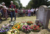 Nigel Crostley lays a wreath at the grave of James Hammett one of the Tolpuddle Martyrs. Tolpuddle Martyrs Festival. Tolpuddle - Paul Box - 2010s,2013,cemeteries,cemetery,floral,flower,flowering,flowers,grave,graves,graveyard,Graveyards,member,member members,members,people,SWTUC,Tolpuddle,Tolpuddle Martyrs' Festival,Trade Union,Trade Unio