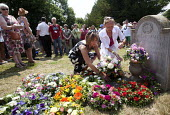 Members of the Tolpuddle martyrs family lay a wreath at the grave of James Hammett one of the Tolpuddle Martyrs. Tolpuddle Martyrs Festival. Tolpuddle - Paul Box - ,2010s,2013,cemeteries,cemetery,families,family,floral,flower,flowering,flowers,grave,graves,graveyard,Graveyards,member,member members,members,people,SWTUC,Tolpuddle,Tolpuddle Martyrs' Festival,Trade