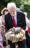 Tony Benn lays a wreath at the grave of James Hammett one of the Tolpuddle Martyrs. Tolpuddle Martyrs Festival. Tolpuddle - Paul Box - 2010s,2013,cemeteries,cemetery,floral,flower,flowering,flowers,grave,graves,graveyard,Graveyards,member,member members,members,people,SWTUC,Tolpuddle,Tolpuddle Martyrs' Festival,Trade Union,Trade Unio
