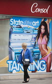 Consol tanning shop, advertisement for sunbeds, Bristol. - Paul Box - 24-08-2013