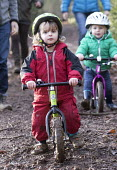 Two 2 year old boys on their balance bikes, Leigh Woods, Bristol - Paul Box - 2010s,2015,access,activities,balance,bicycle,bicycles,BICYCLING,Bicyclist,Bicyclists,bike,bikes,boy,boys,child,CHILDHOOD,children,cities,city,country,countryside,cycle,cycles,cycling,Cyclist,Cyclists,
