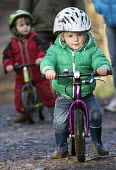 Two 2 year old boys on their balance bikes, Leigh Woods, Bristol - Paul Box - 24-01-2015