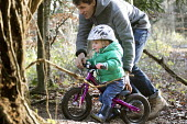 A father with his 2 year old boys on their balance bikes, Leigh Woods, Bristol - Paul Box - 24-01-2015