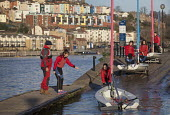 Harbourside sailing school sailing club, Bristol, European Green Capital. - Paul Box - 2010s,2014,adolescence,adolescent,adolescents,boat,boats,Bristol,cities,city,City centre,class,club,clubs,dock,docks,dockside,employee,employees,Employment,female,females,girl,girls,harbor,harbors,har