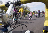Cycle Sunday, roads on Clifton Downs are closed to help children learn to ride a bicycle, Bristol. Car free cycling as the roads are closed to traffic so children can cycle in safety - Paul Box - &,2010s,2015,activities,adult,adults,bicycle,bicycles,BICYCLING,Bicyclist,Bicyclists,BIKE,BIKES,Bristol Green Capital,child,CHILDHOOD,children,cities,city,closed,closing,closure,closures,cycle,cycles,