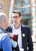 Green party's Darren Hall, Bristol west candidate, talks to a new father outside The Bristol Royal Infirmary, Emergency department, main entrance, Bristol. - Paul Box - 20-04-2015