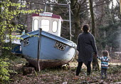 Withdrawn by Luke Jerram, Leigh Woods, Bristol. An art installation of fishing boats that hopes to provoke discussion about climate change, extreme weather, falling fish stocks and our impact on the m... - Paul Box - 2010s,2015,ACE,adult,adults,art,Art Gallery,arts,artwork,artworks,boat,boats,boy,boys,child,CHILDHOOD,children,cities,city,culture,disused,estate,estates,exhibition,families,FAMILY,FEMALE,fine art,fis