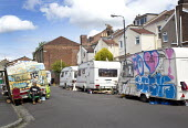 Travellers camp up in residential street, Littleton street, Easton, Bristol - Paul Box - 2010s,2015,camp,camps,caravan,caravans,cities,city,home,male,man,men,mobile,people,person,persons,scene,scenes,Social Issues,soi,spray paint,spray painted,spray painting,street,streets,traveler,travel
