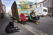 Travellers camp up in residential street, Littleton street, Easton, Bristol - Paul Box - 2010s,2015,animal,animals,camp,camps,canine,caravan,caravans,cities,city,dog,dogs,home,male,man,men,mobile,OWNERSHIP,people,person,persons,pet,pets,scene,scenes,Social Issues,soi,spray paint,spray pai