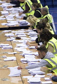 Votes being counted, Bristol West General Election count, Bristol. - Paul Box - 2010s,2015,ballot ballots,ballot papers,cities,city,council workers,count,count counting,democracy,election,election elections,elections,general election,local,paper,people,POL,pol politics,political,