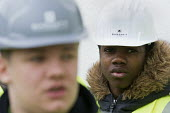 Pupils visit new energy efficient homes, Barratt Homes, Hanham Hall, Bristol - Paul Box - 2010s,2015,adolescence,adolescent,adolescents,BAME,BAMEs,Black,BME,bmes,boy,boys,builder,builders,building,building site,BUILDINGS,child,CHILDHOOD,children,cities,city,Construction Industry,diversity,