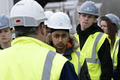Pupils visit new energy efficient homes, Barratt Homes, Hanham Hall, Bristol - Paul Box - 2010s,2015,adolescence,adolescent,adolescents,Asian,Asians,BAME,BAMEs,black,BME,bmes,boy,boys,builder,builders,building,building site,BUILDINGS,child,CHILDHOOD,children,cities,city,communicating,commu