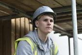 An apprencice carpenter, New energy efficient homes, Barratt Homes, Hanham Hall, Bristol - Paul Box - 2010s,2015,adolescence,adolescent,adolescents,apprentice,apprentices,apprenticeship,apprenticeships,boy,boys,builder,builders,building,building site,Building Worker,BUILDINGS,carpenter,child,CHILDHOOD