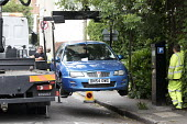 Residents protesting at new resident parking scheme, St Pauls, Bristol. Cars being lifted and moved. - Paul Box - 17-06-2015