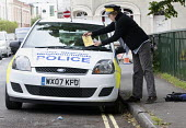 Residents protesting at new resident parking scheme, St Pauls, Bristol. A protestor dressed as a parking attendant issuing mock parking tickets. - Paul Box - 17-06-2015