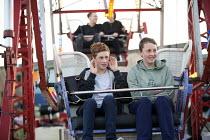 Dismaland a parody of Disneyland theme park by Banksy, Weston Super Mare. Riding the ferris wheel. Bemusement Park. - Paul Box - 27-08-2015