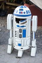 Dismaland a parody of Disneyland theme park by Banksy, Weston Super Mare. Broken Star Wars R2 -D2 at the Bemusement Park. - Paul Box - 27-08-2015