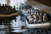 Dismaland a parody of Disneyland theme park by Banksy, Weston Super Mare. A drive a boat pond with boats full of refugees at the Bemusement Park. - Paul Box - 27-08-2015