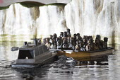 Dismaland a parody of Disneyland theme park by Banksy, Weston Super Mare. A drive a boat pond with boats full of refugees and the White Cliffs of Dover at the Bemusement Park. - Paul Box - 27-08-2015