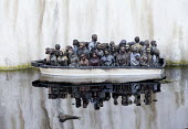Dismaland a parody of Disneyland theme park by Banksy, Weston Super Mare. A drive a boat pond with boats full of refugees at the Bemusement Park. - Paul Box - 07-09-2015