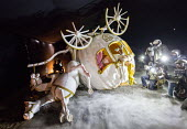 Dismaland a parody of Disneyland theme park by Banksy, Weston Super Mare. Disney princess Cinderella horse drawn pumpkin carriage coach crash with paparazzi press photographers in motorcycle helmets,... - Paul Box - 07-09-2015