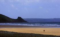 A couple walking on the beach Pembrokeshire. Newgale beach Wales - Paul Box - 01-12-2003