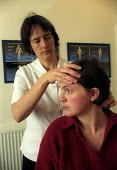 A patient visits a chiropractor for a back massage, Bristol - Paul Box - 01-12-2003