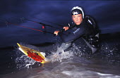 Kite surfer sufing the waves. - Paul Box - 18-07-2003