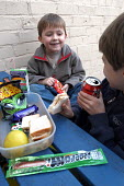 A young boy eats his packed lunch - Paul Box - 17-02-2004