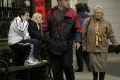 Teenagers and elderly lady in high street Tenby, Pembrokeshire, Wales - Paul Box - 20-01-2004