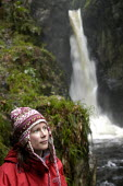 A walker looks by a waterfall in the Lake district - Paul Box - 20-01-2004
