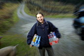 A teenage girl with her cases of alco pops for a party. - Paul Box - 01-01-2004