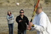 adults play soft ball on beach , Wales - Paul Box - 01-01-2004